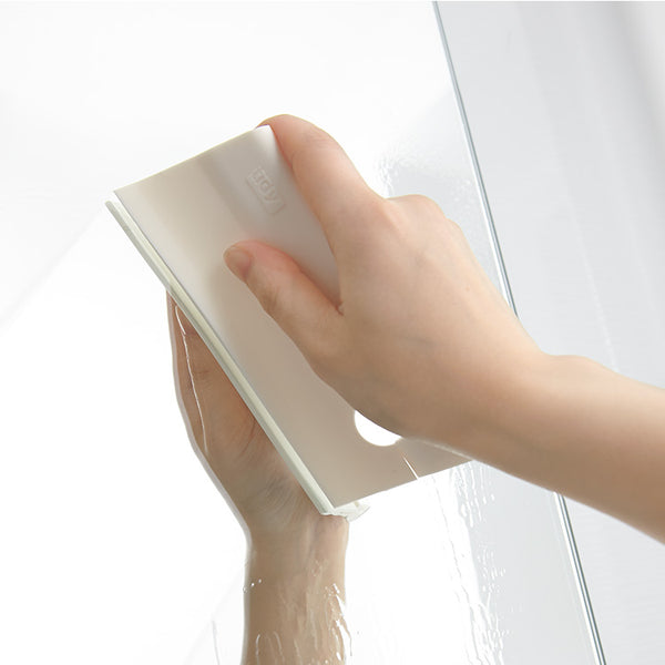 For keeping your bathroom dry and mildew-free, Squeegee is soft and easy to use. Use after bathing to keep steam and water drops from building up on walls and mirrors. It's made of quality silicone and has a hole with a slit for hanging on any bar.