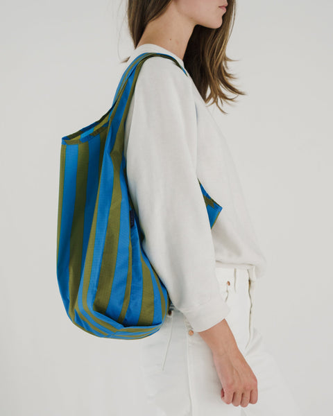 Minimalist reusable ripstop nylon bag by Baggu. Perfect for packing your day's groceries, lunch, or any everyday essentials. Now in Cyan Stripe for Spring. at Port of Raleigh