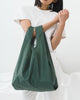 Minimalist reusable ripstop nylon bag by Baggu in dark sage green
