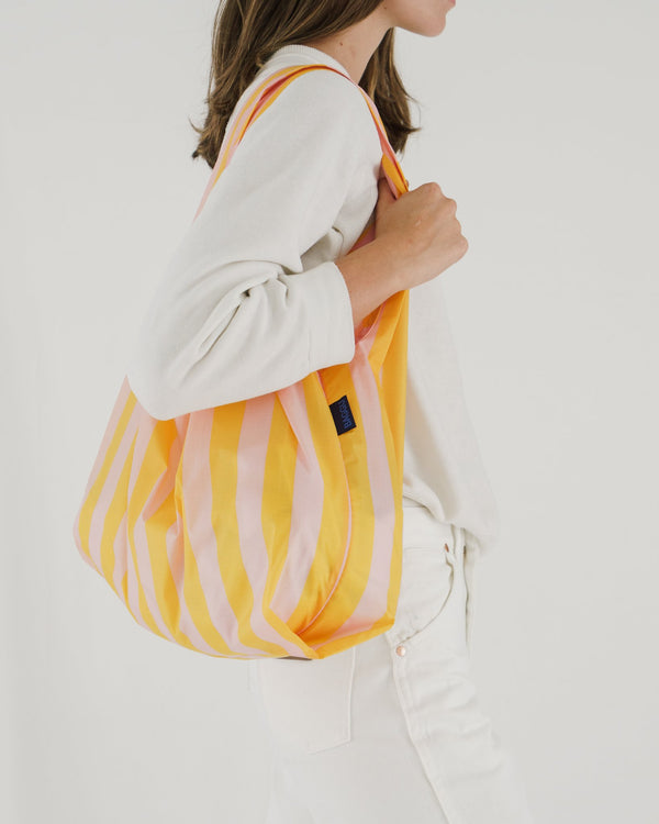 Minimalist reusable ripstop nylon bag by Baggu. Perfect for packing your day's groceries, lunch, or any everyday essentials. Now in Marigold Stripe for Spring.