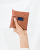 Minimalist reusable ripstop nylon bag by Baggu in terracotta at Port of Raleigh