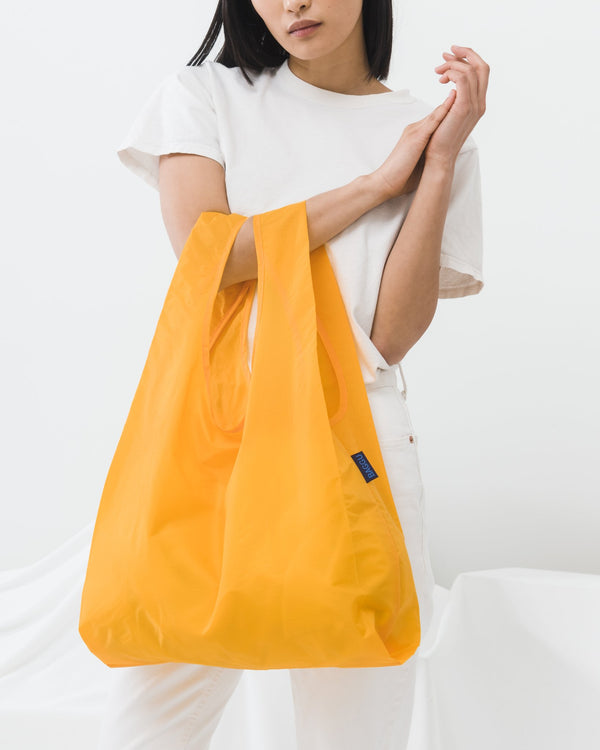 Minimalist reusable ripstop nylon bag by Baggu in Yolk