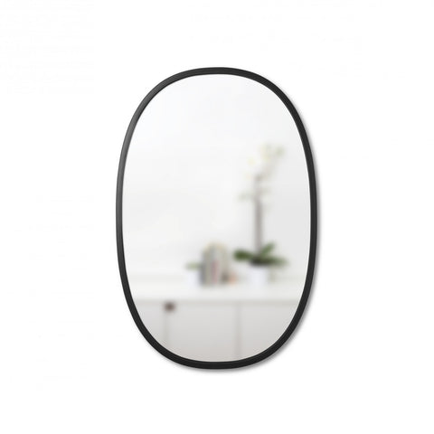 Simple oval wall mirror with thin black rubber trim for entryway, living space, or bathroom. Hangs vertically or horizontally. By Umbra
