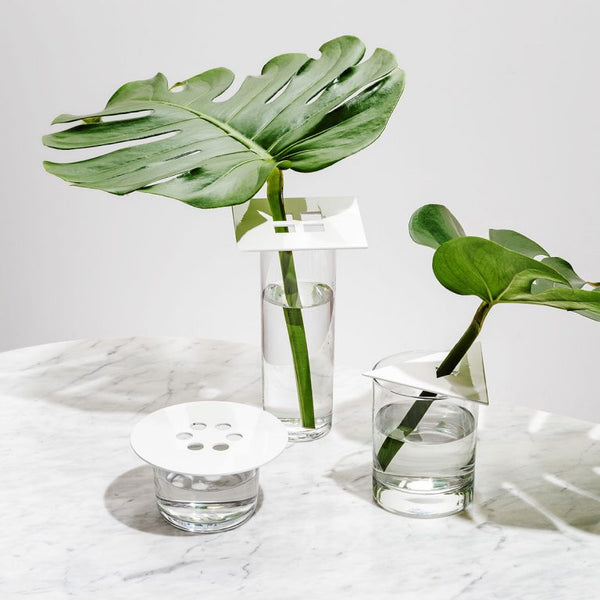 3 modern shapes in powder coated steel are the perfect way to instantly turn any vessel into a vase. Simply put any stem, branch, or whole bouquet into the holes to create an arrangement or accent to your tabletops. Made in the USA by Fruitsuper.