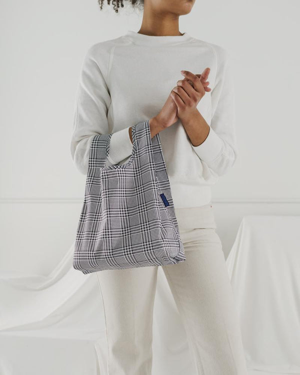 Baby Baggu resuable shopping bag in a herringbone plaid print for everyday use from carrying groceries, travel, lunch tote, or children's items.