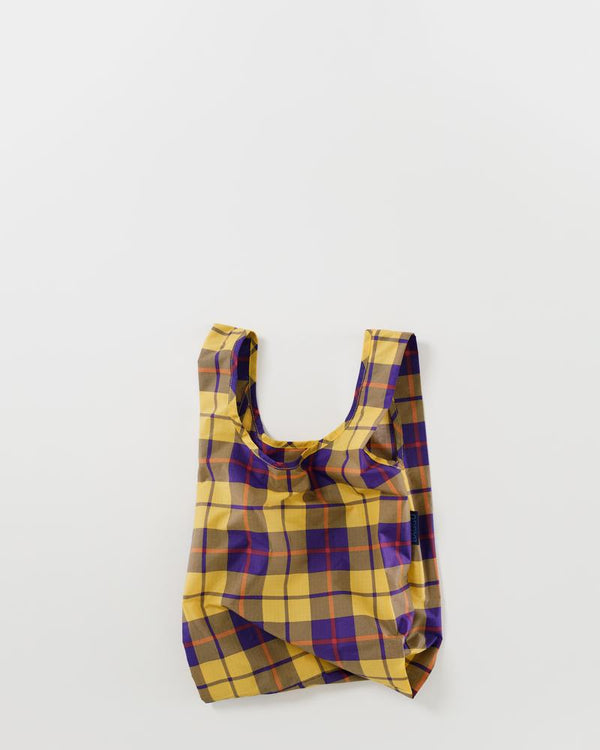 Baby Baggu resuable shopping bag in a tartan plaid print for everyday use from carrying groceries, travel, lunch tote, or children's items.