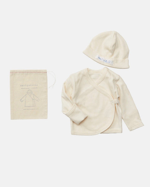 A baby cap and cardigan set that will start your newborn days in natural softness and warmth. Made with 100% organic cotton in Japan, the tie front cardigan and skull cap will keep your baby warm with cozy. at Port of Raleigh
