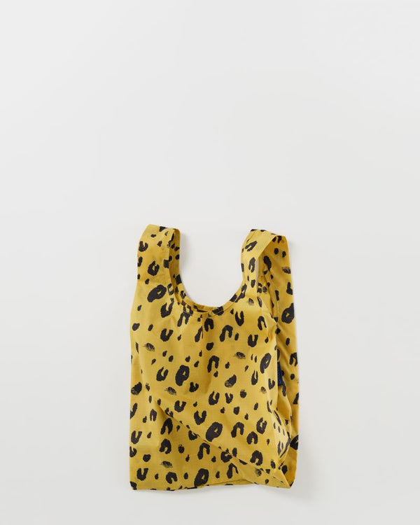Baby Baggu resuable shopping bag in a fun and striking leopard print for everyday use from carrying groceries, travel, lunch tote, or children's items.