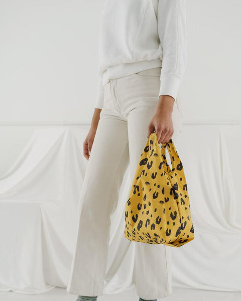 Baby Baggu resuable shopping bag in a fun and striking leopard print for everyday use from carrying groceries, travel, lunch tote, or children's items. at Port of Raleigh