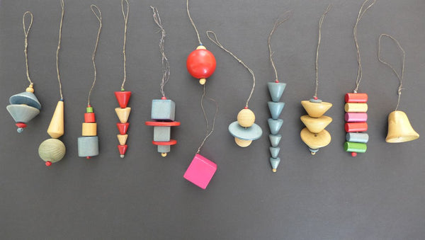 Set of 12 minimal, traditional style wood ornaments crafted in honor of the Bauhaus centennial. Handmade in the Black Forest of Germany.