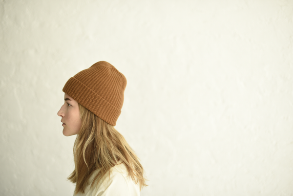 Knit beanie made from 100% Scottish ribbed knit cashmere. Perfect for cold days and adding a colorful touch to your outfits. made in USA.