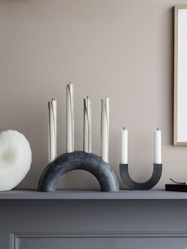 Solid black marble candle holder, in a simple bow-shaped design. Holds 4 taper candles, making the perfect table or console centerpiece. Danish design by Ferm Living.