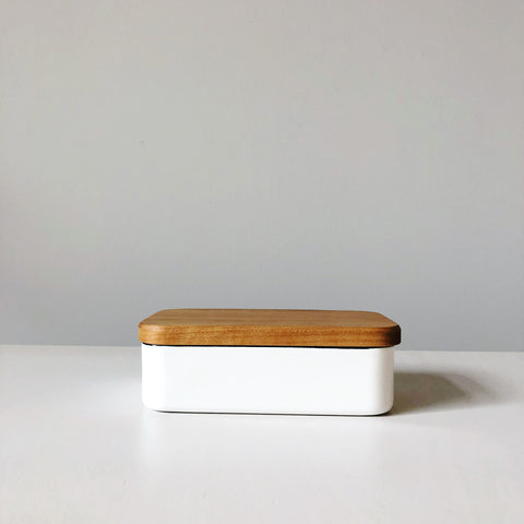 A butter dish that stores well and looks sleek, this enamel dish and wood lid are interchangeable, making it the perfect piece for both home dining and entertaining. Made in Japan, this is a kitchen must-have.