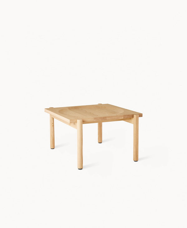 A Japanese and Swedish inspired coffee table with simple but striking details. Made of solid ash wood with a circular impression in the middle that displays decorative objects. Designed by Dims.