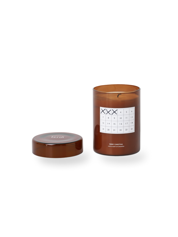 A modern candle to honor the Danish tradition of Kalenderlys, the glass features a calendar chart to mark off each day you burn it up till Christmas Eve. Made with palm oil and soy wax it emits the perfectly nostalgic cinnamon scent. Made in China with palm oil and soy wax.