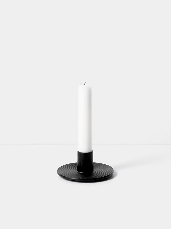 Simple yet thoughtful, this cast iron candle holder from Ferm Living is the perfect touch to any surface. Holds a single taper candle, finished in black.
