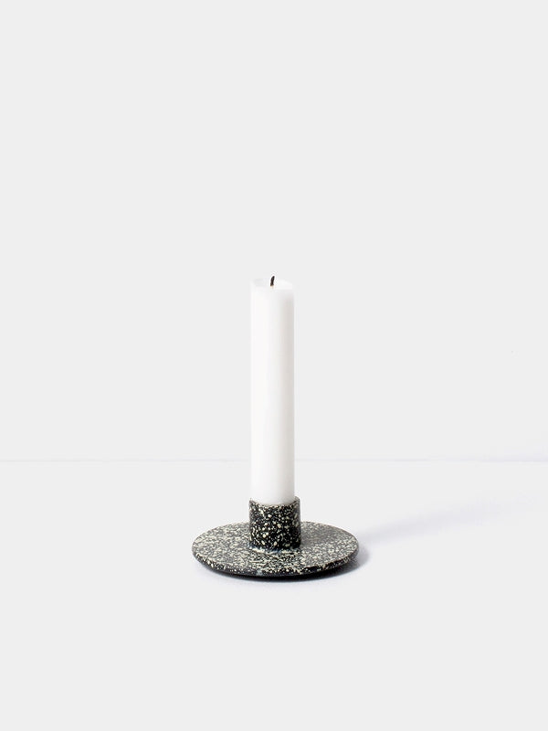 Simple yet thoughtful, this cast iron candle holder from Ferm Living is the perfect touch to any surface. Holds a single taper candle, finished in black. at Port of Raleigh