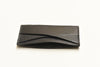 A classic leather card case with beautiful texture and optimal storage for carrying money lightly. A simple but considered design, it has hand-painted exterior edges and quality stitching to maintain the quality and longevity of your case and your cards. at Port of Raleigh