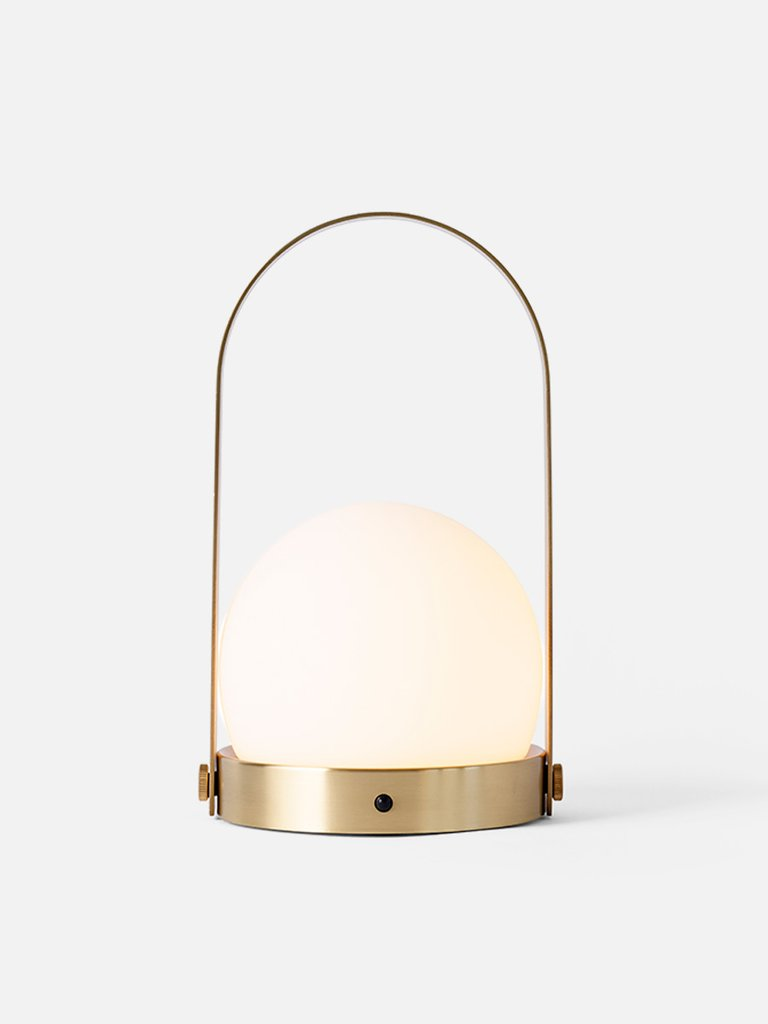 Modern and minimalist Portable and Chargeable Carrie LED Lamp by Danish design studio Menu. Now in a Brushed Brass finish. at Port of Raleigh