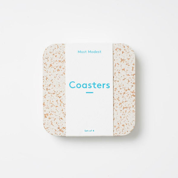 "Natural coasters with a chic and functional design. Made of natural rubber and cork, these coasters are naturally non-slip and heat resistant. Comes in a set of 4, measuring 4""x4."""
