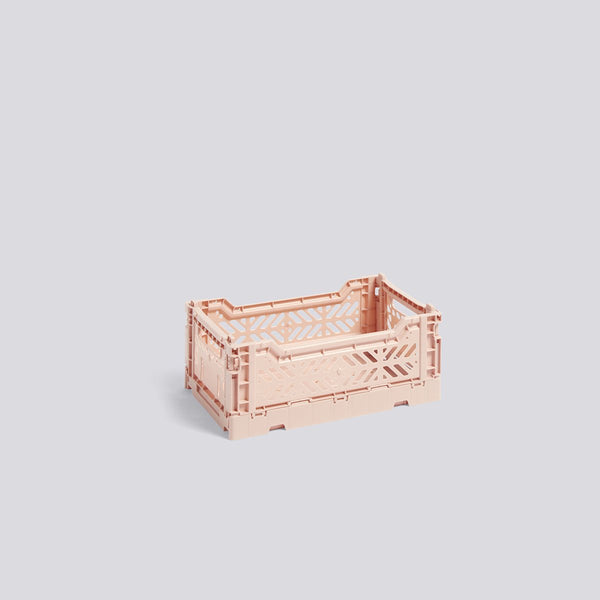 A versatile storage solution, these simple plastic crates stack together and fold down flat, keeping things organized and saving precious space. Designed by HAY, made in Turkey.