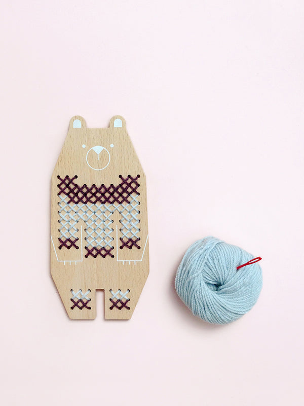 Bear cross stitch craft kit comes with 100% wool yarn in two tones, a safe plastic needle & a play booklet with tutorial + patterns. By Moon Picnic