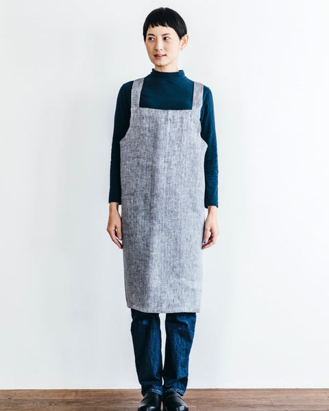 The classic apron with a cross back for all of your kitchen duties. Made in Japan by the beloved Fog Linen, these aprons are made in a mid weight herringbone weave linen, with a large front pocket and easy slip-on design.  at Port of Raleigh