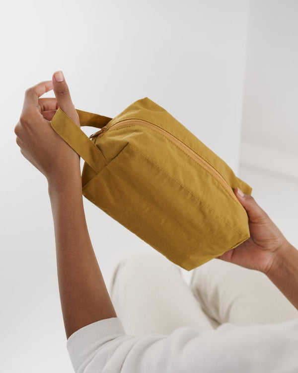 Simple, effortless and minimally designed Dopp kit, perfect for travel, made from heavyweight nylon with three interior pockets. machine washable, designed in New York.