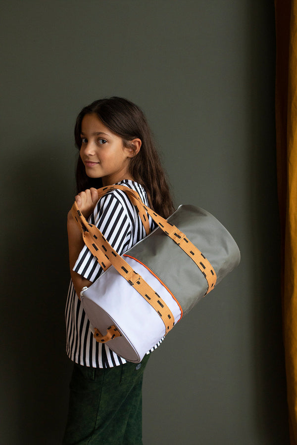 Modern duffle bag for little and big kids alike in modern color combination by Sticky Lemon. Made of recycled PET water bottles, this durable and water proof Nylon canvas is perfect for school, work, and urban adventures.