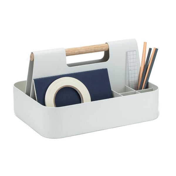 Your trusty toolbox meets your desk organizer in the bright and modern Elin desk and workshop caddy from Most Modest. Made with powder coated aluminum with perfectly sized compartments and a white oak wood handle, you can proudly store your tools on top of your table instead of underneath it.
