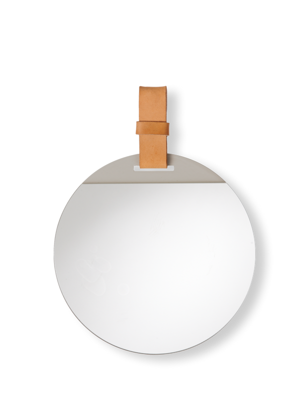 Simple and sleek small wall mirror with hanging leather strap for mounting on the wall with ease. A design collaboration between Ferm Living and Søren Rose Studio. Made in China.