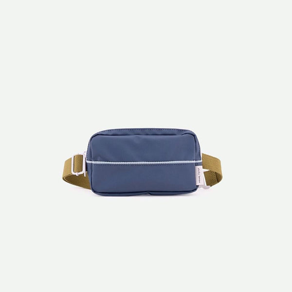 Modern fanny pack for little and big kids alike in modern color combination by Sticky Lemon. Made of recycled PET water bottles, this durable and water proof Nylon canvas is perfect for school, work, and urban adventures.