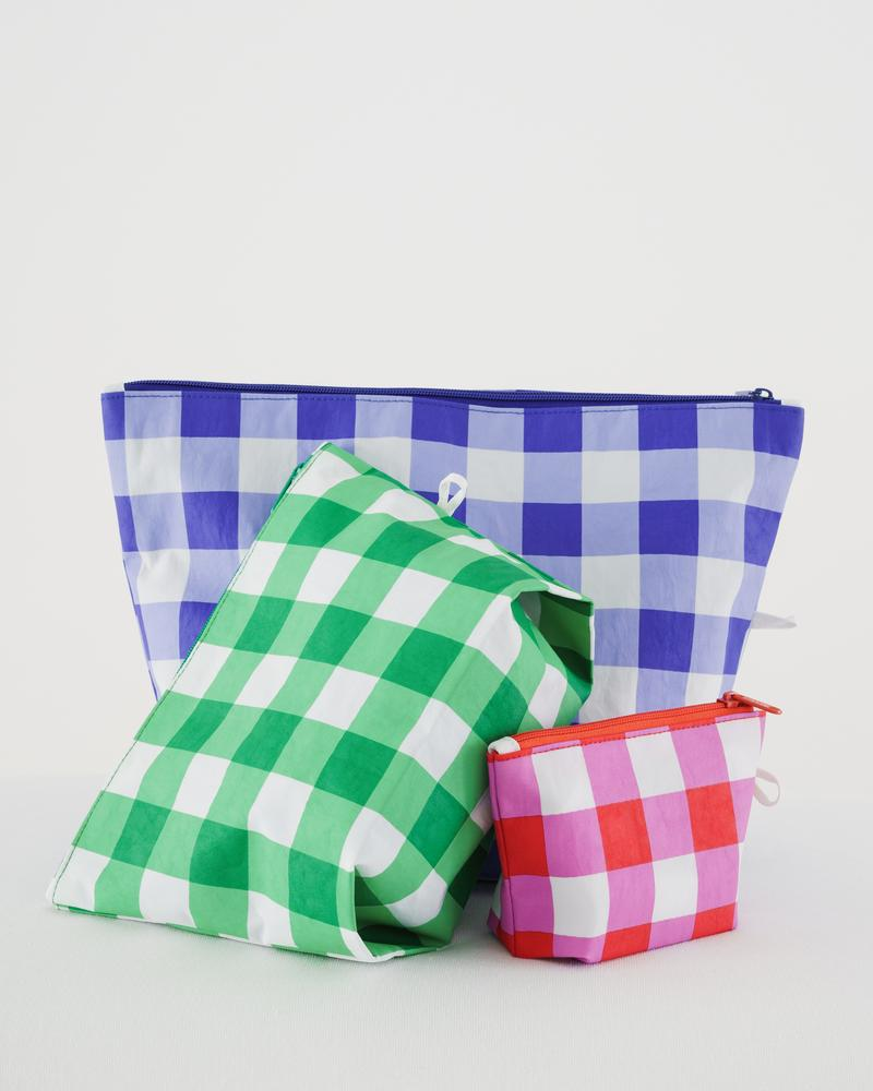 Go Pouch travel and organization zip pouches sold in a set of three with small, medium, large. Made of thick durable nylon by Baggu. Now in a summer-rich checkered pattern. at Port of Raleigh