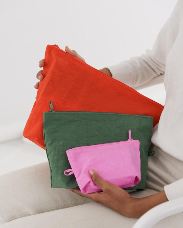 Go Pouch travel and organization zip pouches sold in a set of three with small, medium, large. Made of thick durable nylon by Baggu