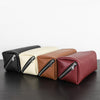 Minimalist natural leather travel dopp kit that converts into tray. Made in USA by Calila
