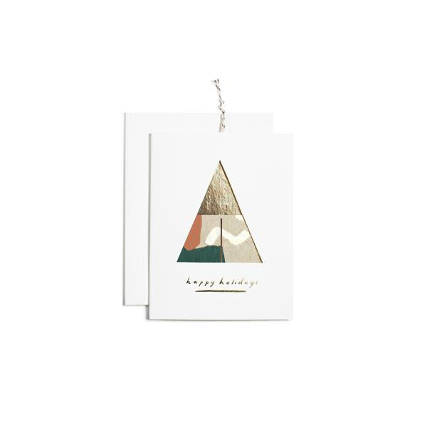 Wish a Merry Christmas with this modern, hand painted card with 2 flat circles inside that assemble into an ornament. Each card is white foil stamped, and comes with a solid white envelope and gold string for hanging. Painted in Iowa by Moglea.