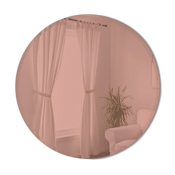 "Modern, simple, and minimalist 36"" round wall mirror in copper colored glass finish with a beveled edge by Umbra"