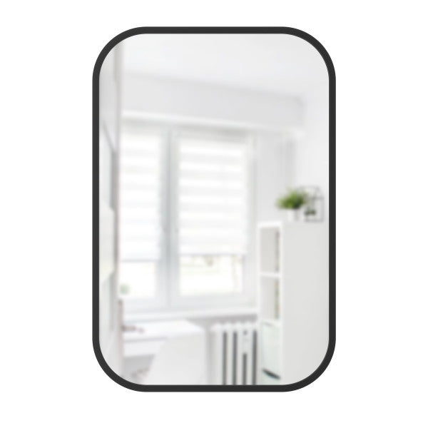 Simple rounded rectangle wall mirror with thin rubber trim for entryway, living space, or bathroom. Hangs vertically or horizontally. By Umbra