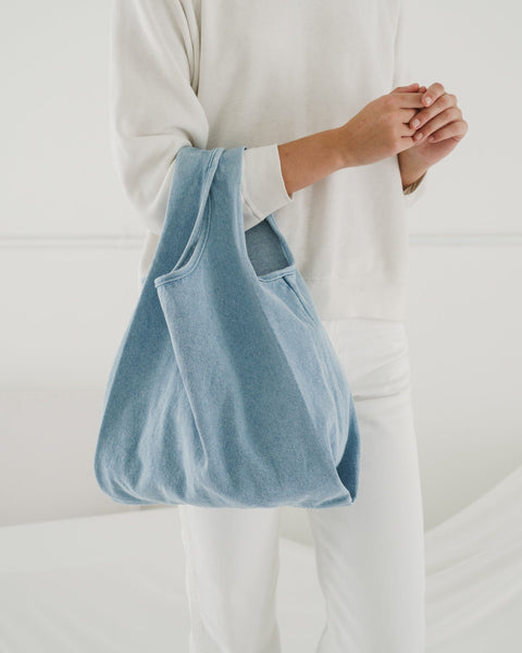Take your everyday shopping bag and make it in washed and worn denim. This medium sized classic shape from Baggu is perfect for carrying your essentials, kids' toys, school materials, or even tech gear.  at Port of Raleigh