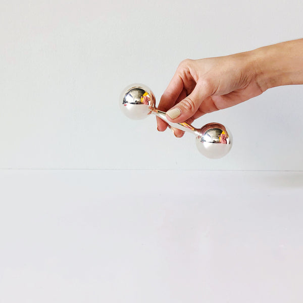 Timeless, classic yet modern and minimal silver Harmony Bell Rattle for baby by Areaware