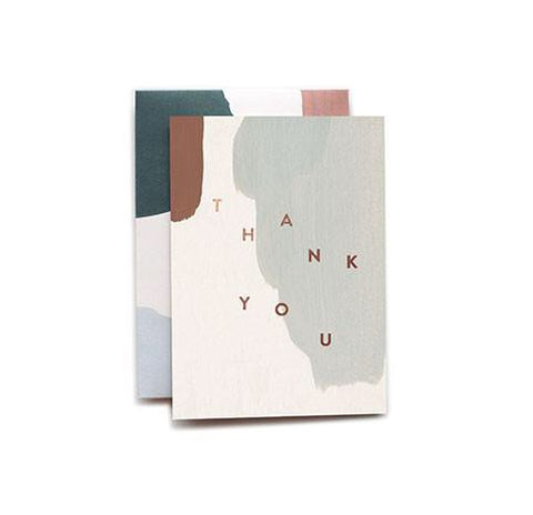 Say Thank You with this muted paint strokes card from Iowa based studio, Moglea. Copper foil stamped and comes with a patterned envelope.