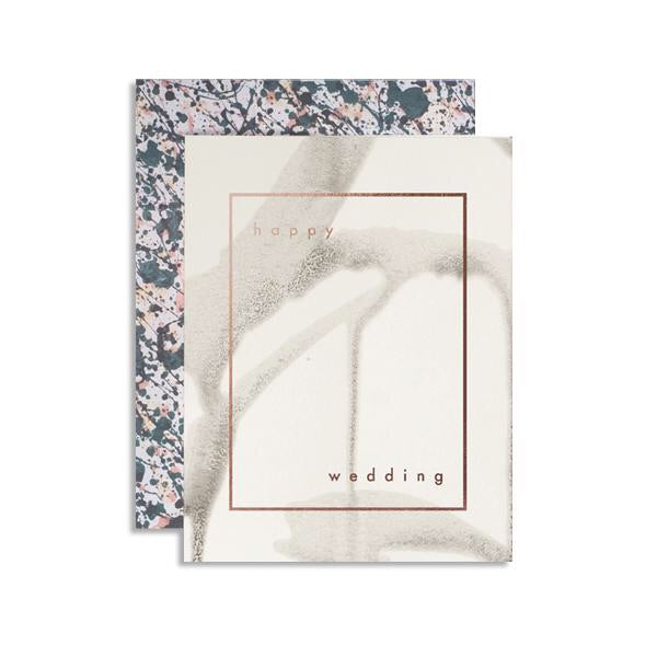 Drippy neutral colors and a colorful envelope say Happy Wedding with intention and beauty. A copper foil stamped card from Iowa based studio, Moglea. at Port of Raleigh