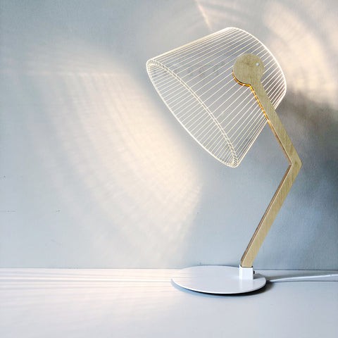 An alluring and fun LED lamp made of glass but convinces the eye that there is a shade. Designed by Studio Cheha, this LED Table Lamp table is the perfectly modern and unique addition to any room in your home.