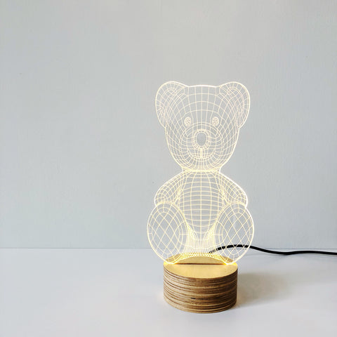 An alluring and fun Bear LED lamp made of glass but convinces the eye that there is a shade. Designed by Studio Cheha, this Teddy Bear Lamp is the perfect accent to a child's bedside or any table in your home.