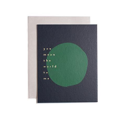 Give a world of meaning in this hand painted and hand stamped card from Iowa based studio, Moglea. Rich navy and green with gold foil and a clean, grey envelope. at Port of Raleigh