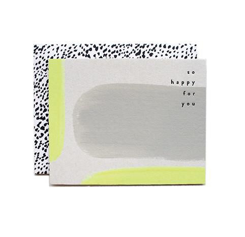 Say your congratulations with this neon painted card from Iowa based studio, Moglea. Hand painted on rpulpboard with a patterned envelope. at Port of Raleigh