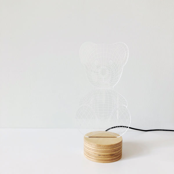 An alluring and fun Teddy Bear LED lamp made of glass but convinces the eye that there is a shade. Designed by Studio Cheha, this Teddy Bear Lamp is the perfect accent to a child's bedside or any table in your home.