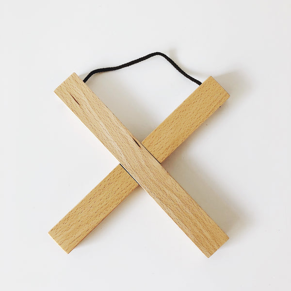 Japanese design and beautiful Chestnut wood come together to create this timeless and modern trivet. Two wood planks create a cross shape and act as a lovely protector for your kitchen and table surfaces. To disassemble, simply pull the planks apart and then use the attached rope to hang for easy and efficient storage.
