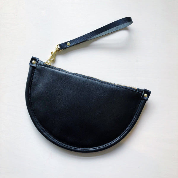 Smaller than a purse, but larger than just a wallet, the pouch is perfect for on-the-go. Made in NYC with vegetable tanned leather, this pouch has a zipper and a detachable leather strap to let you go hands-free for traveling, evenings out, or just running errands. at Port of Raleigh