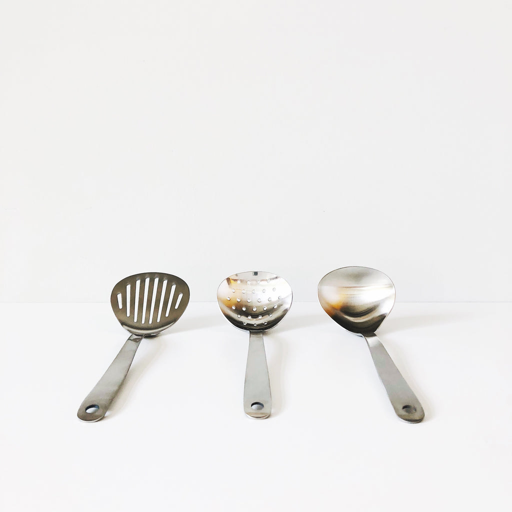 Three essential Japanese utensils for every kitchen made in stainless steel by Sori Yanagi. Set includes ladle, spatula, and serving spoon. at Port of Raleigh